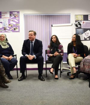 Cameron accused of stigmatising Muslim women with 'learn English' policy