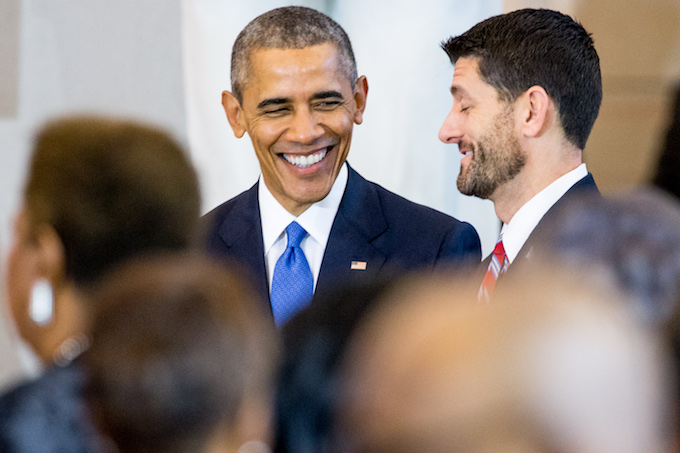 FILE - In this Dec. 9, 2015 file photo, President Barack Obama speaks with House Speaker Paul Ryan of Wis., right, during a commemoration ceremony for the 150th anniversary of the ratification of the 13th Amendment to the U.S. Constitution which abolished slavery in the United States, in Emancipation Hall on Capitol Hill in Washington. Congressional leaders and the White House reached an agreement on a massive year-end tax and spending package last week, without shutting down the government. The deal represented something once commonplace in Washington: a compromise, with elements for all sides to like and dislike.   (AP Photo/Andrew Harnik)