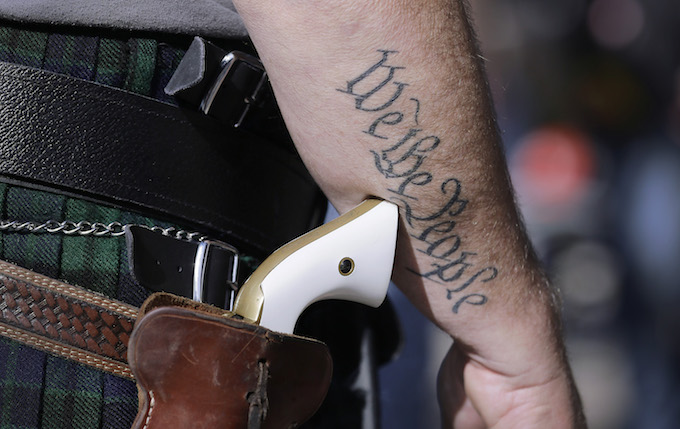 Gun owners openly carry to spur conversation about new law