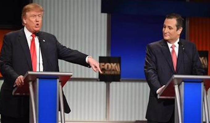 Republican presidential candidate, businessman Donald Trump speaks as Republican presidential candidate, Sen. Ted Cruz, R-Texas, looks on during the Fox Business Network Republican presidential debate at the North Charleston Coliseum, Thursday, Jan. 14, 2016, in North Charleston, S.C. (AP Photo/Rainier Ehrhardt)