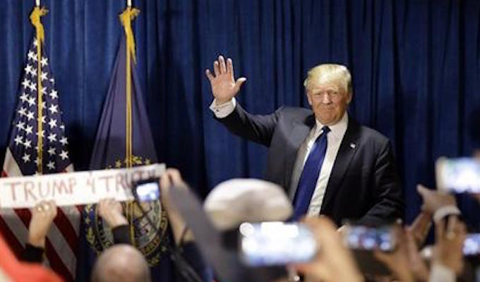 Republican presidential candidate, businessman Donald Trump takes the stage to speak to supporters during a primary night rally, Tuesday, Feb. 9, 2016, in Manchester, N.H. (AP Photo/David Goldman)