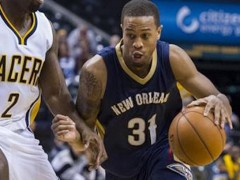 FILE - In this Oct. 3, 2015, file photo, New Orleans Pelicans' Bryce Dejean-Jones (31) drives the ball around the defense of Indiana Pacers' Rodney Stuckey (2) during the first half of a preseason NBA basketball game in Indianapolis. Police say Saturday, May 28, 2016,  Dejean-Jones was fatally shot after breaking down the door to a Dallas apartment. Sr. Cpl. DeMarquis Black said in a statement that officers were called early Saturday morning and found the 23-year-old player collapsed in an outdoor passageway. He was taken to a hospital where he died.  (AP Photo/Doug McSchooler, File)