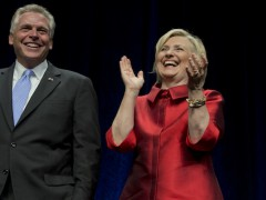 File - Democratic presidential candidate Hillary Rodham Clinton walks on the stage with Virginia Gov. Terry McAuliffe, center, at a Jefferson Jackson event hosted by the Democratic Party of Virginia at George Mason University's Patriot Center, in Fairfax, Va., Friday, June 26, 2015.   (AP Photo/Manuel Balce Ceneta)