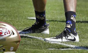 Kaepernick wears socks depicting cops as pigs. Kezar Stadium in San Francisco. (AP Photo/Ben Margot)