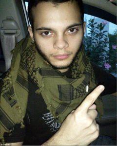 Esteban Santiago gives the ISIS one finger salute.
