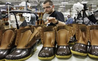 FILE - In this Dec. 14, 2011, file photo, Eric Rego stitches boots in the facility where LL Bean boots are assembled in Brunswick, Maine. L.L. Bean has a backlog of 51,000 orders for their famous boots that it intends to fill in the coming weeks. A company spokeswoman says harsh winter weather and the boot's ongoing popularity are driving demand. (AP Photo/Pat Wellenbach, File)