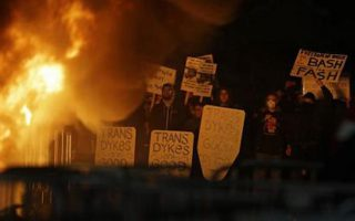 Protestors watch a fire on Sproul Plaza during a rally against the scheduled speaking appearance by Breitbart News editor Milo Yiannopoulos on the University of California at Berkeley campus on Wednesday, Feb. 1, 2017, in Berkeley, Calif. The event was canceled out of safety concerns after protesters hurled smoke bombs, broke windows and started a bonfire. (AP Photo/Ben Margot)