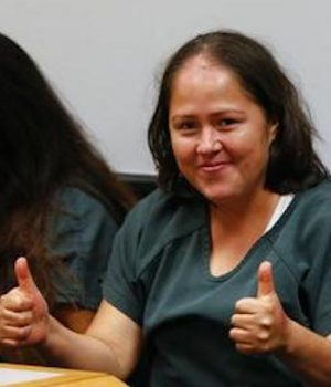 Smiles and thumbs up from illegal alien charged with killing her family