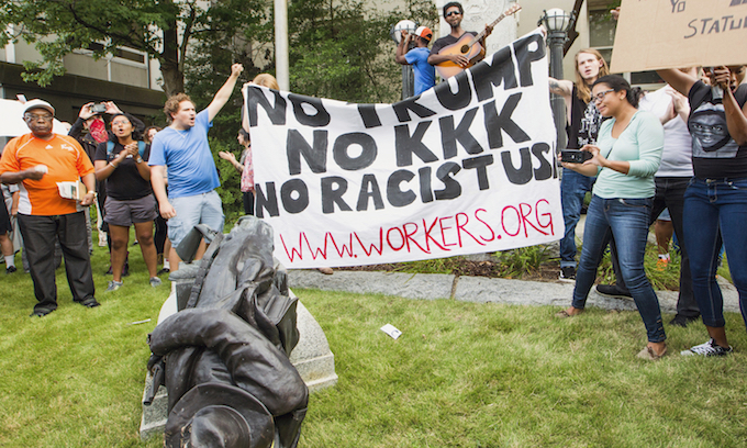 Protesters tear down Confederate monument in Durham, N.C.