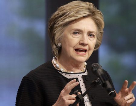 Hillary Clinton, breathing easy now, hints at Trump impeachment