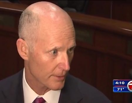Fla. governor signs school security, gun control bill; NRA sues state
