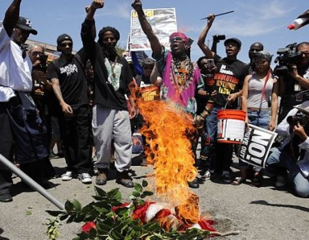 Supporters of Maxine Waters burn American flag outside her office