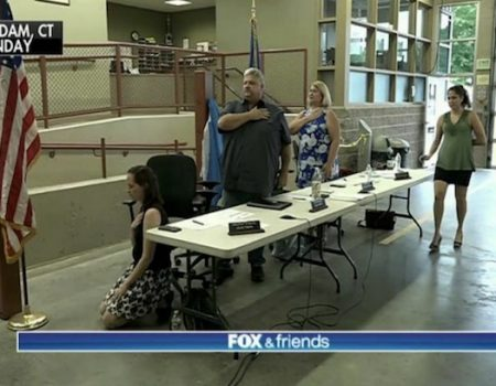 Ct. official kneels again during Pledge of Allegiance; rants about flag cakes