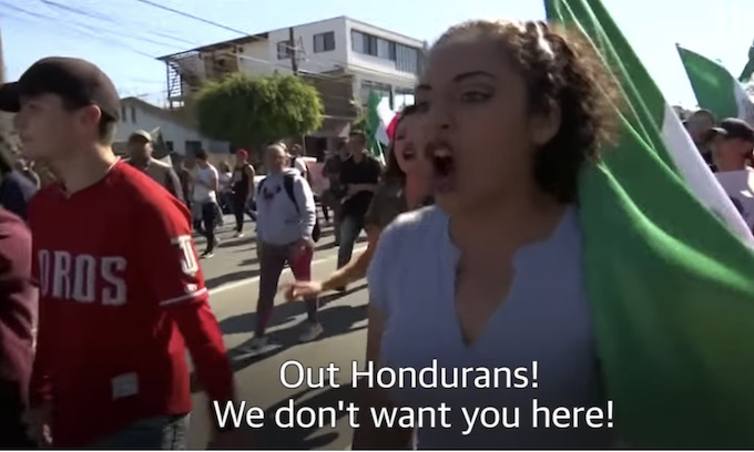 Tijuana residents protest, call caravan an 'invasion', shout 'out'