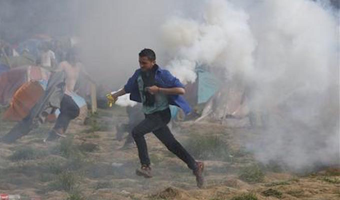 Migrants tear gassed as they try to break through border