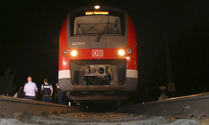 Muslim migrant attacked German train passengers with ax