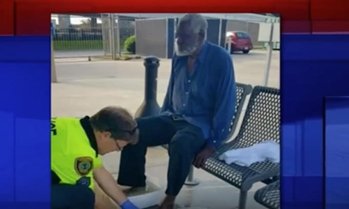 White cop washes feet of black, blind homeless man