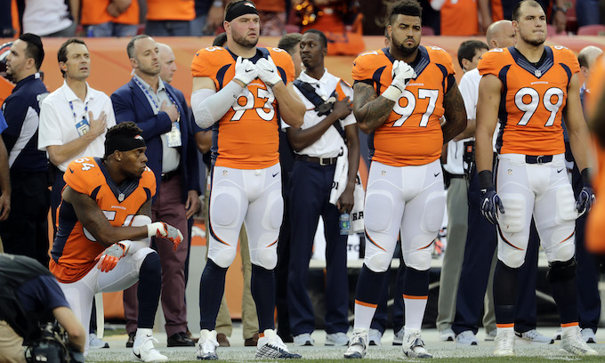 Another team, another NFL player takes a knee during anthem