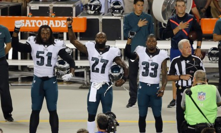 Eagles players raise fists to national anthem at Soldier Field