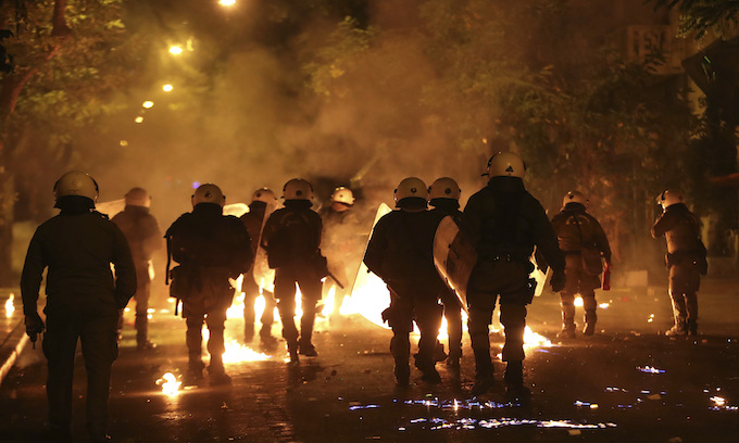 Obama throws verbal firebombs in Greece as protesters against him riot in the streets