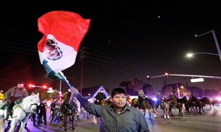 Agitators waving Mexican flags declare, 'This is the new America!'