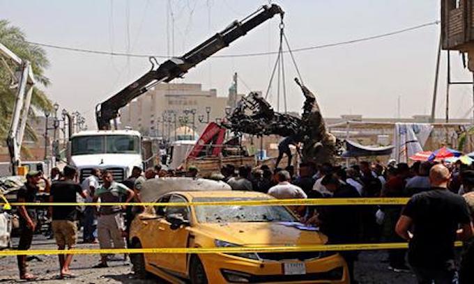 Car bomb kills at least 10 people at Baghdad ice cream shop