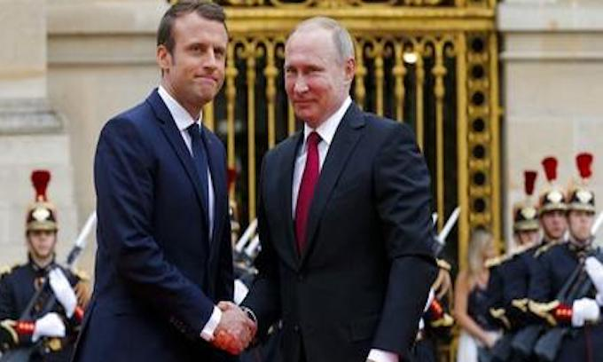 France's Macron decries Russian media's 'fake news' while hosting Putin