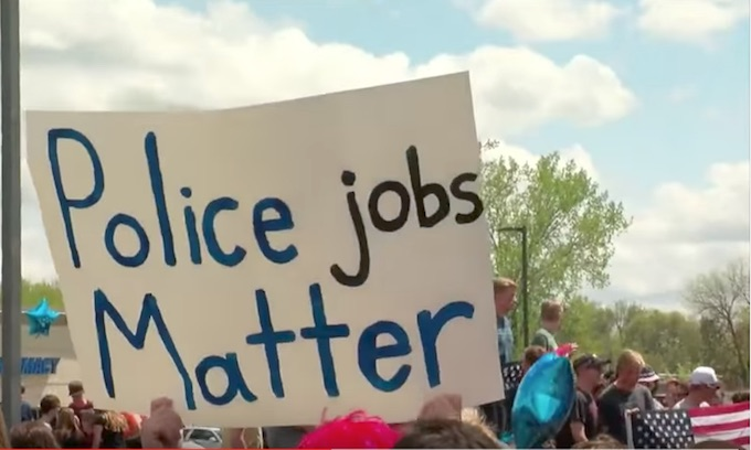 Forest Lake adults, HS students protest disbanding of police force