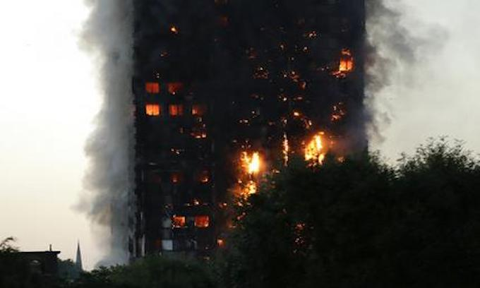 London inferno as 27 story residential building burns