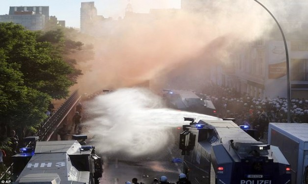 G20 – German police fire water cannon and pepper spray at black-clad bottle-hurling demonstrators