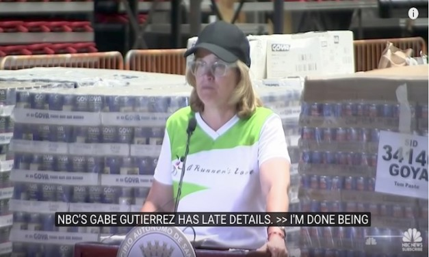 Mayor stands amid pallets of supplies to complain she has no help
