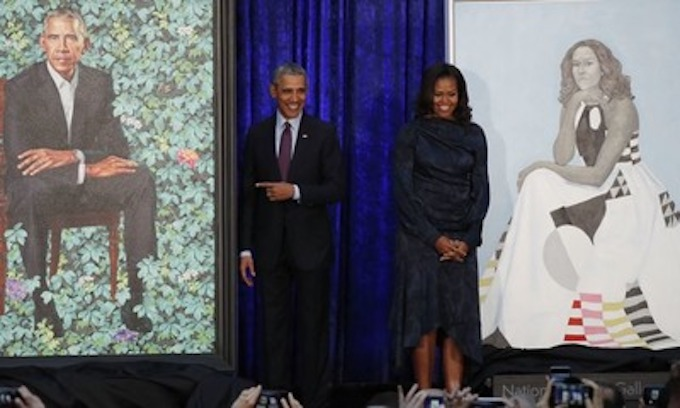 Obama praises wife Michelle's 'hotness' as official portraits unveiled