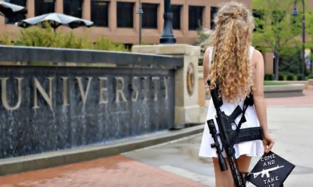 Kent State 'gun girl' says she received 'riot' welcome at Ohio University