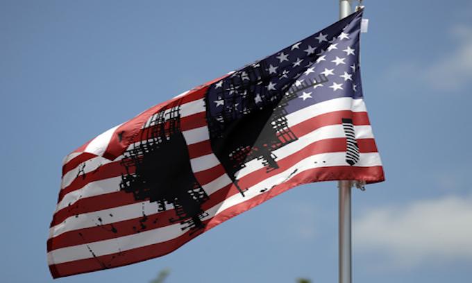 Univ. of Kansas flies desecrated US flag; Gov. tells them to take it down