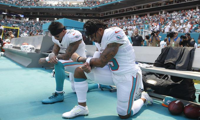 Kaepernick cheers as NFL players kneel