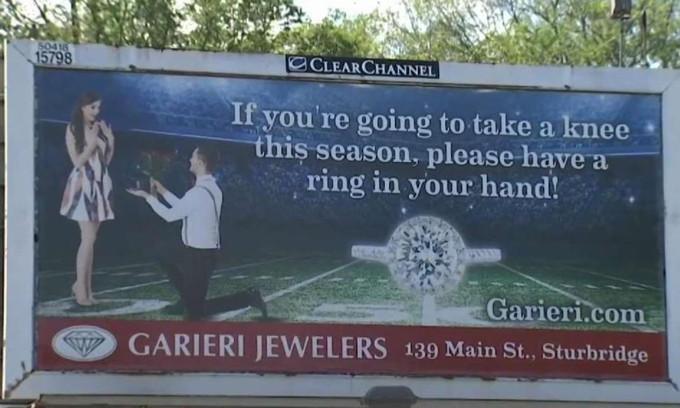 Jeweler gets death threats for 'take a knee' billboard