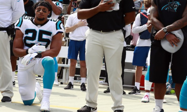 Panthers hire Eric Reid, allow him to kneel during national anthem