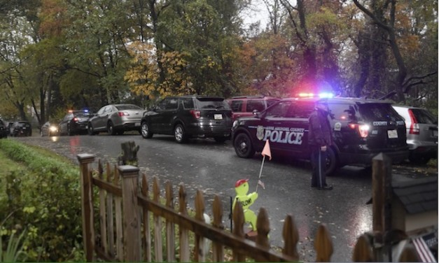 Police say officers fatally shot armed man while serving protective order to remove guns