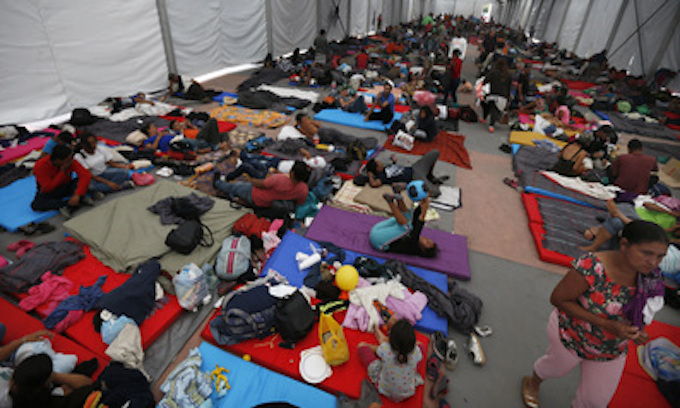 Central Americans straggle into Mexico City to shelter at stadium