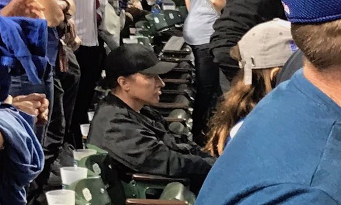 John Cusack takes on 'flag-sucking halfwits' after being shown sitting during military salute