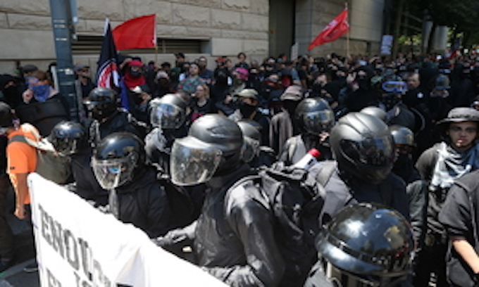 Portland police plan to stencil large 3-digit numbers on officers' helmets for protests