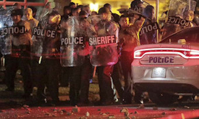 25 officers injured when angry Memphis crowd attacks police