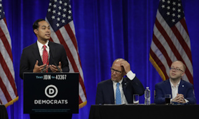 Democrat candidates focus on climate change in town halls as Trump comments