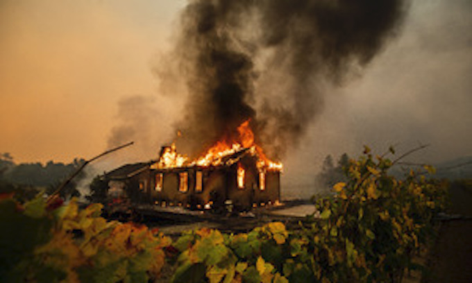 More blackouts planned as major wildfire torches Northern California