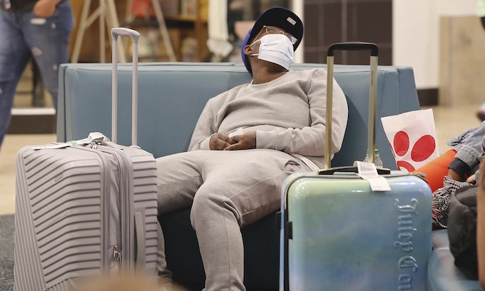 Devastated airlines now requiring passengers to wear masks and to sit rows apart