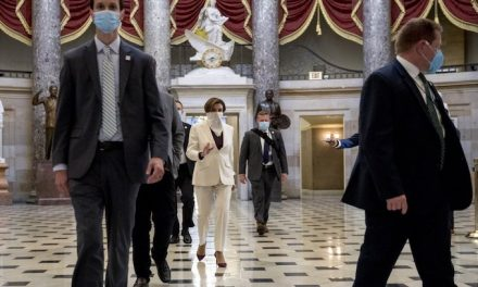 Called to vote, House members put in a masked appearance