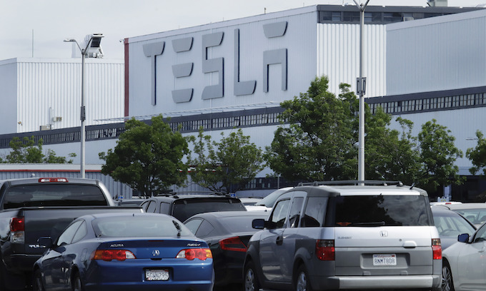 Tesla fuels re-opening debate as employees come back to work