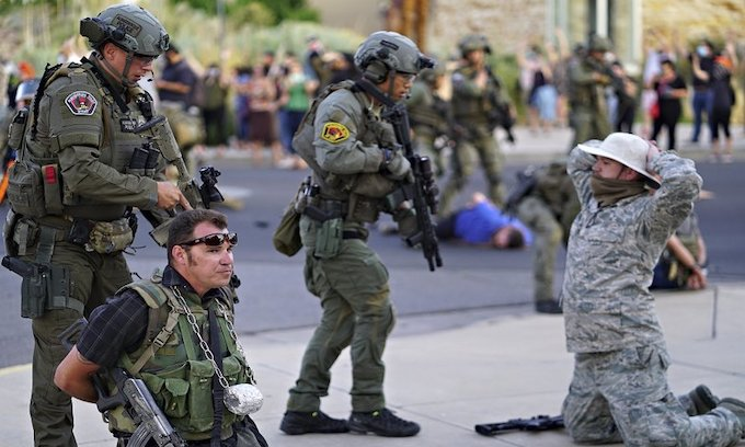 Man shot in Albuquerque as armed citizens try to defend conquistador statue from rioters