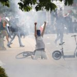 Federal judge orders Denver police to limit firing tear gas, projectiles at peaceful protesters