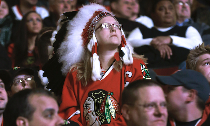 Blackhawks ban fans from wearing Native American headdresses to their games